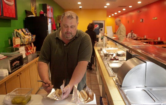 From 2013: Mark Carter prepares  hot dogs at his Carter?s Nearly World Famous Hot Dogs  in the Muncie Mall.  Photos by Kurt Hostetler/The Star Press Mark Carter prepares some hot dogs in his shop in the mall. Restaurant scene in the Muncie Mall.