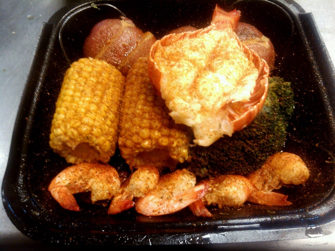 Seafood Sensation: Lobster tail with potatoes, corn and shrimp.
