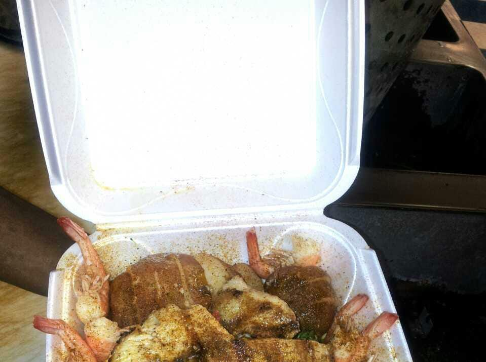 Seafood Sensation: Seasoned shrimp and fish with vegetables.