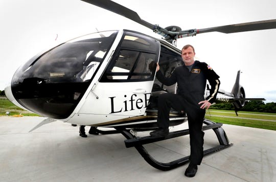 LifeFlight pilot Zachary Haufler stands in front of the new Airbus H130 located at the newly built base at Murfreesboro Airport.