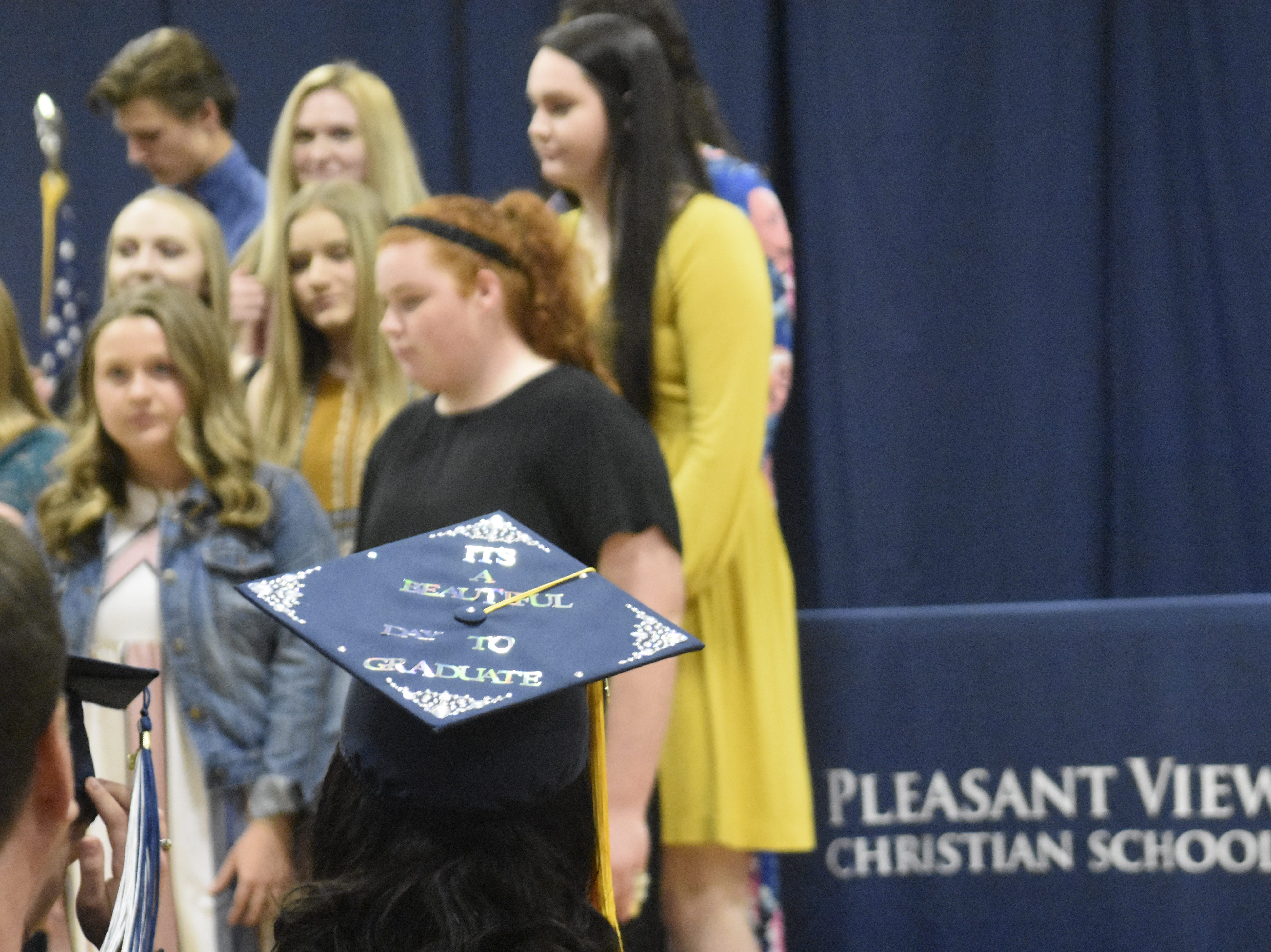 """It's a beautiful day to graduate,"" reads a decorated graduation cap at Pleasant View Christian School on Monday, May 13."