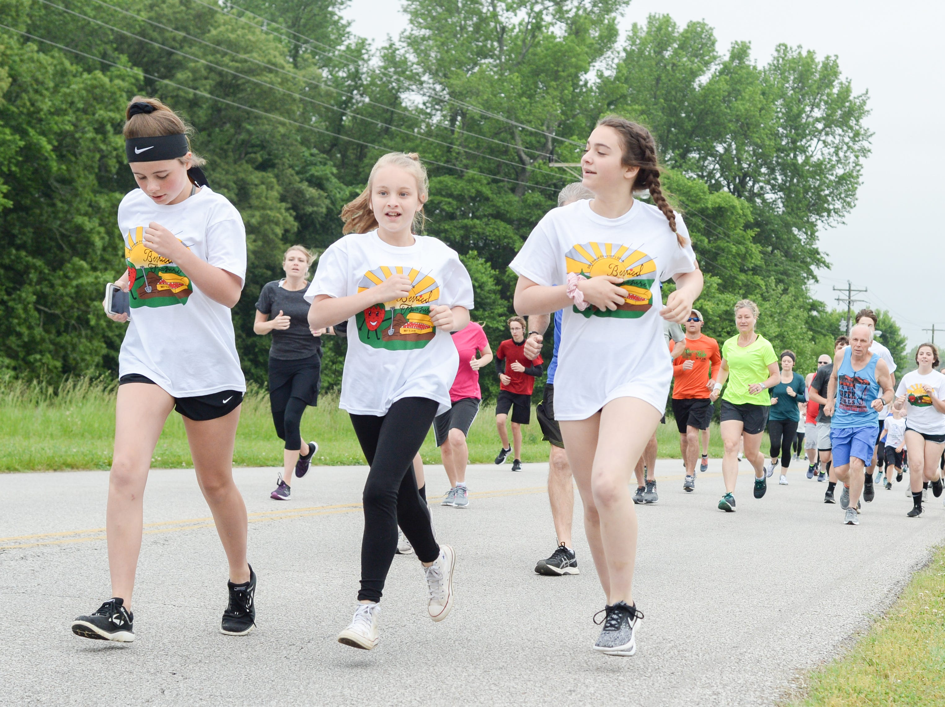 Participants put their best foot forward during the Strawberry Stride at Portland High School during the 78th Annual Middle Tennessee Strawberry Festival presented by the Portland Chamber of Commerce in Portland on Saturday, May 11.