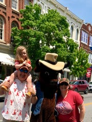 Meghan Guffee and her family at a past rodeo parade.