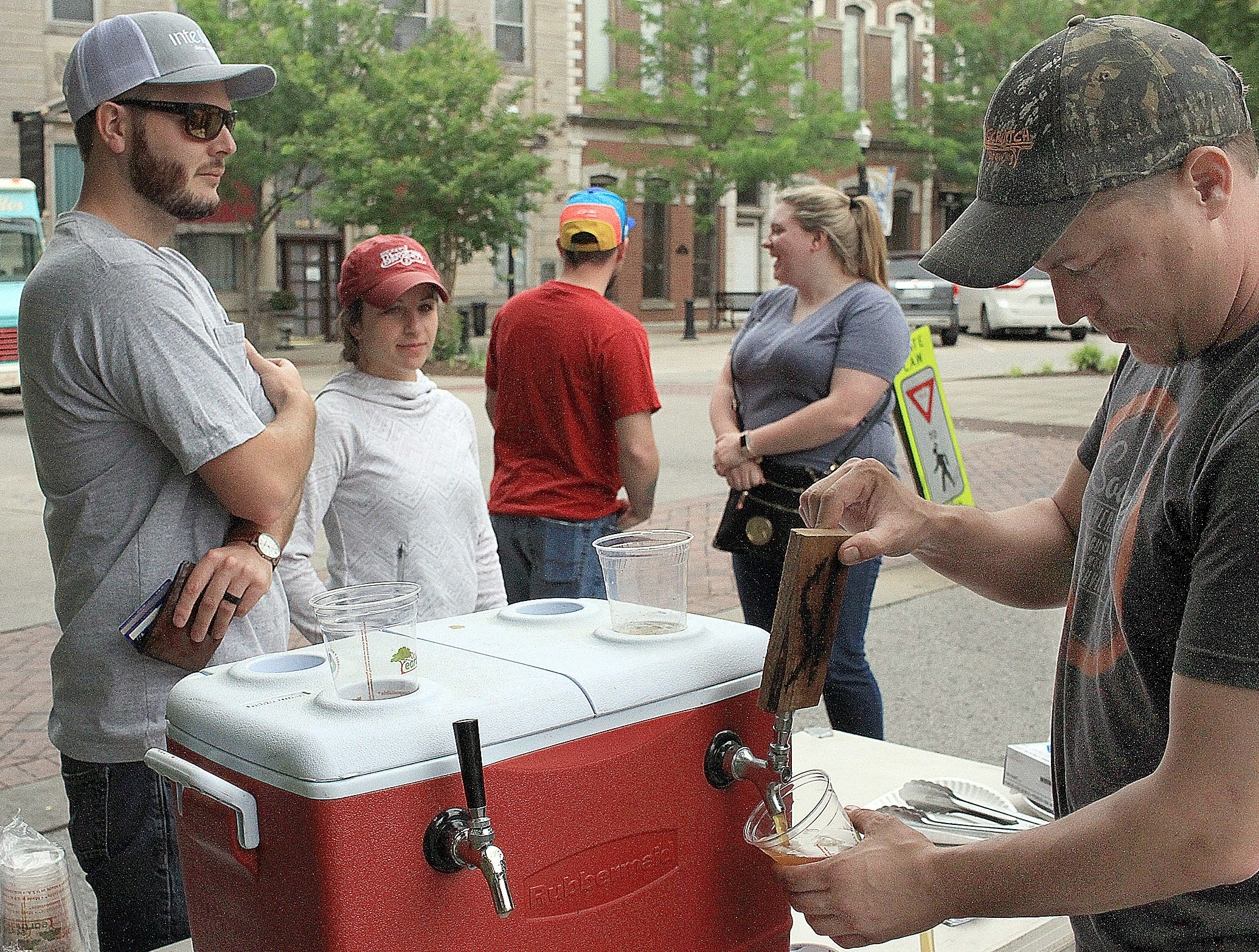 Brad Singleton from Filly's pours beers for Trent and Angelica Williams at the Fashion Crawl in Gallatin, TN on Saturday, May 11, 2019.
