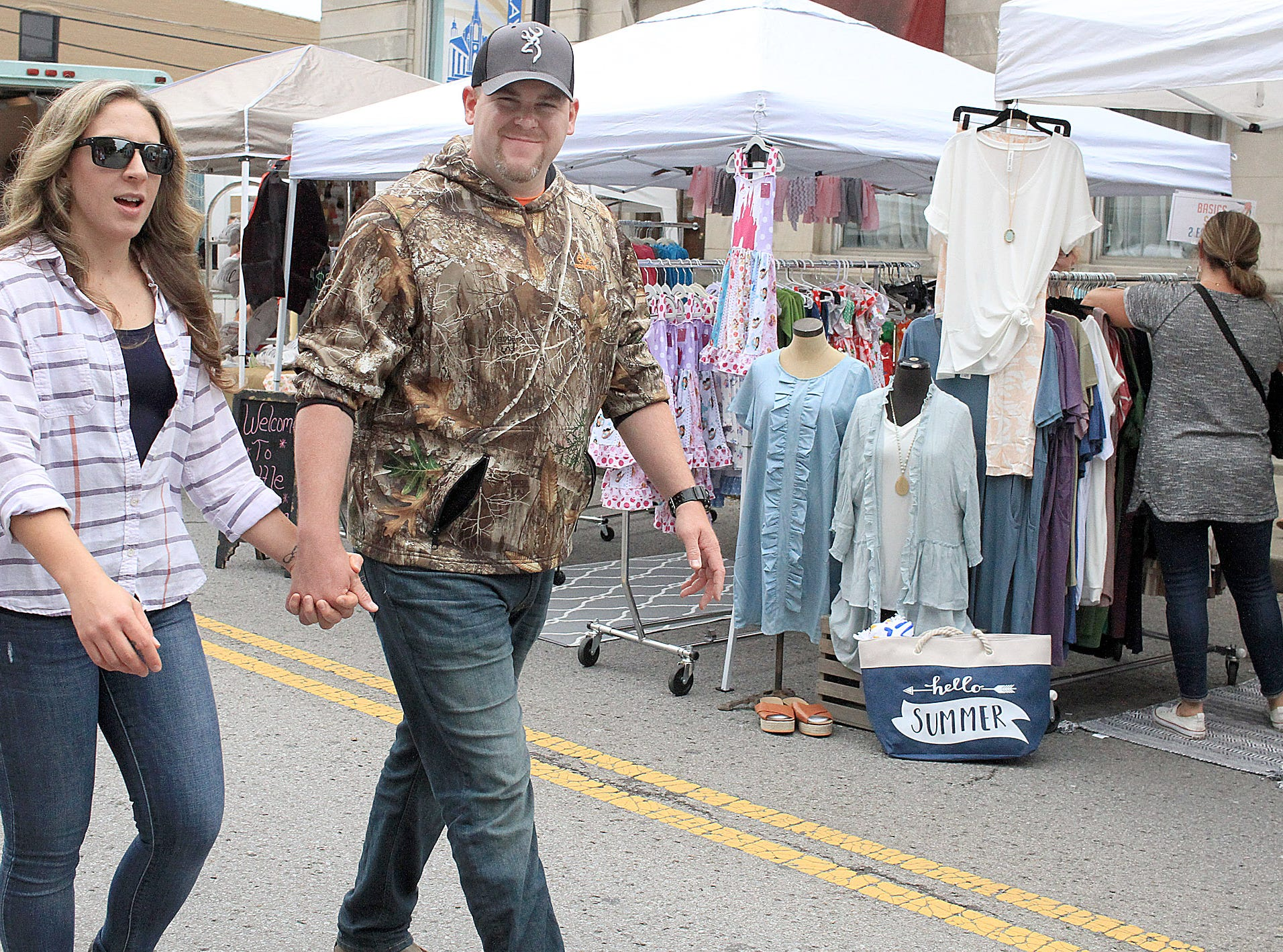 Kristine Friedman and James Petre hold hands as the walk the Fashion Crawl in Gallatn, TN on Saturday, Nay 11, 2019.