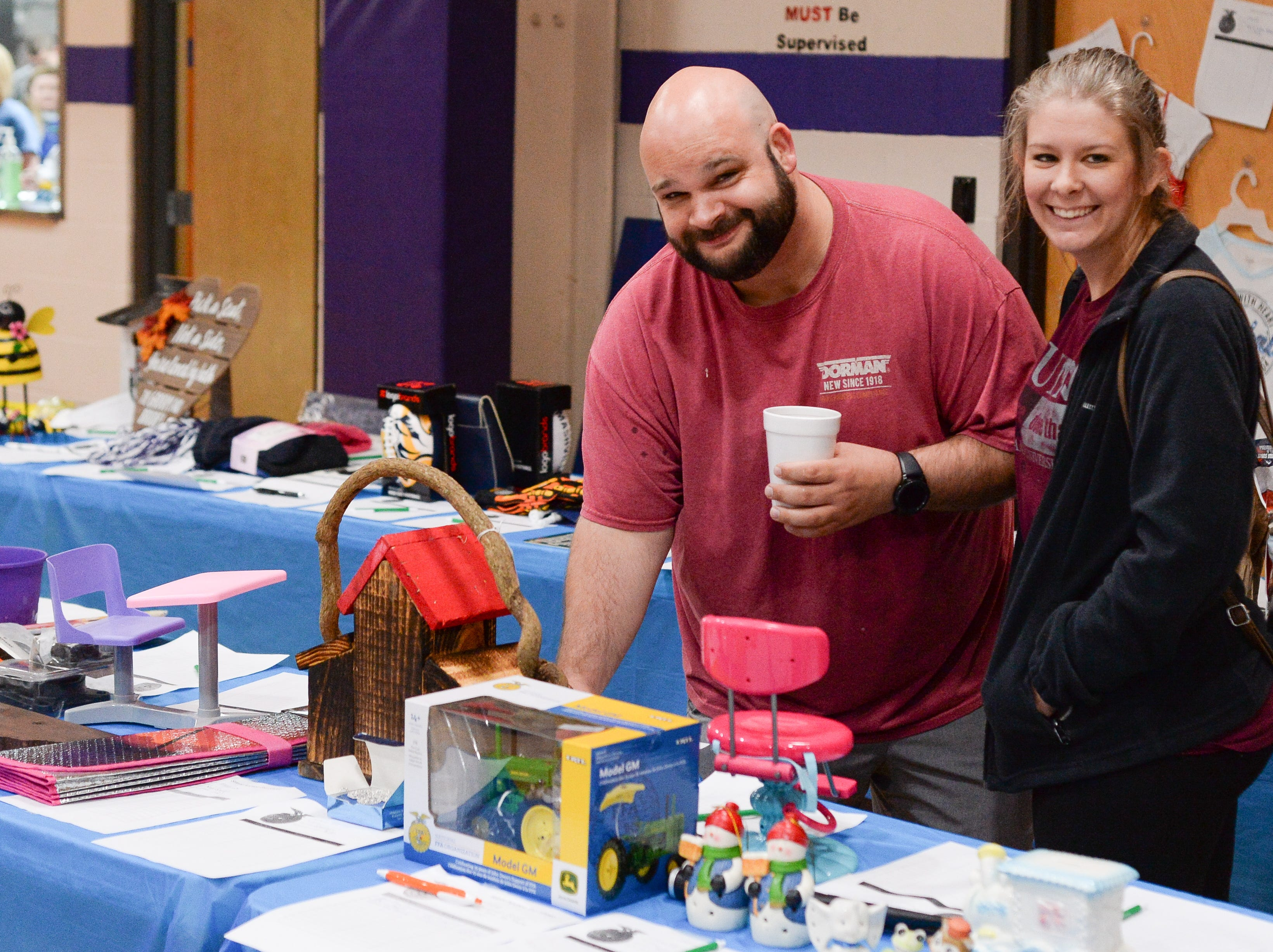 Cory Hulan and Kala Dixon participate in a silent auction during the Strawberry Festival Pancake Breakfast & Silent Auction presented by the Portland Rotary Club & Portland FFA at First Baptist Church Portland on Saturday, May 11.
