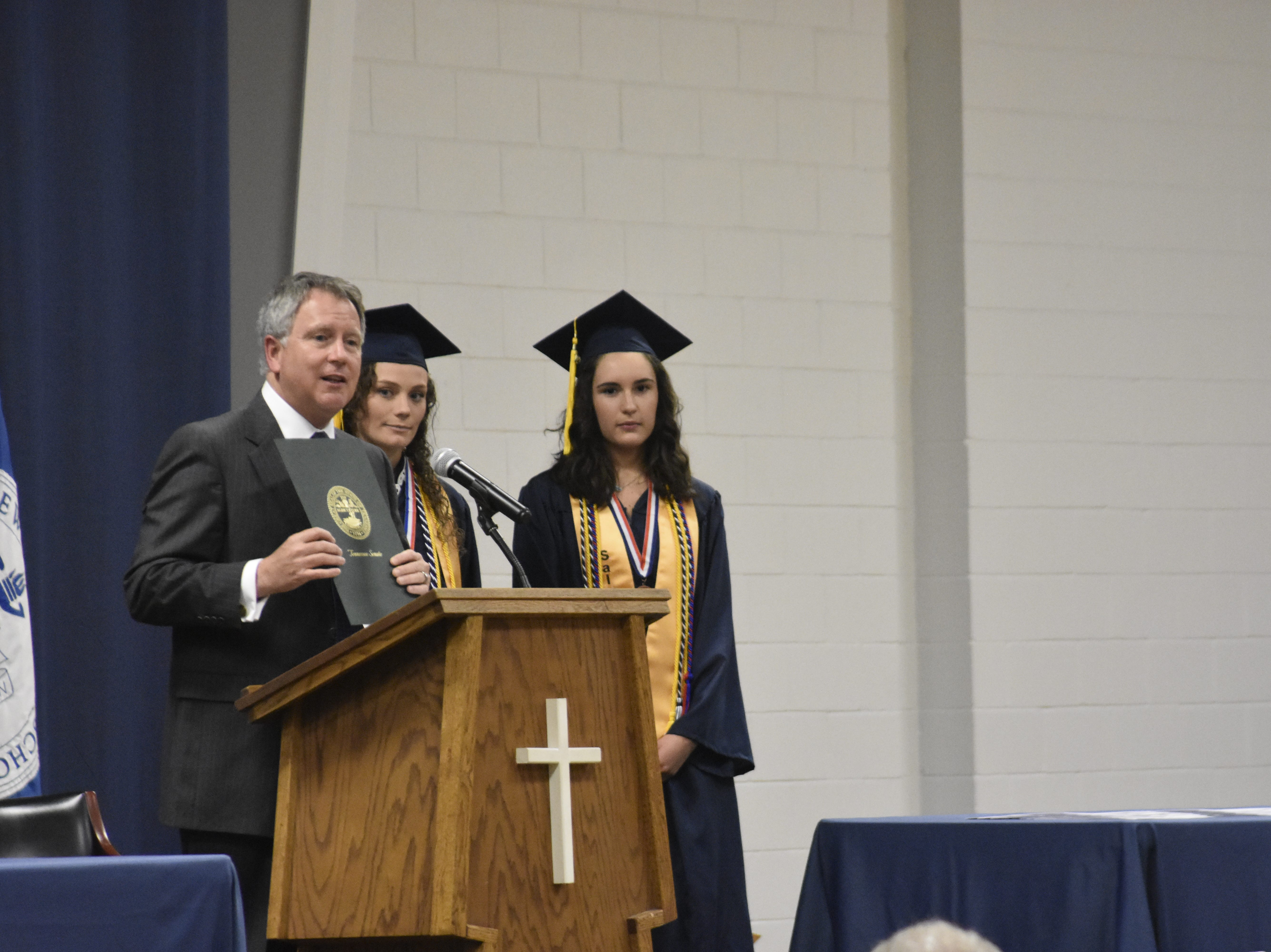 Sen. Kerry Roberts recognizes Valedictorian Kylah Kivette and Salutatorian Bethany Milling at Pleasant View Christian School's graduation on Monday, May 13.