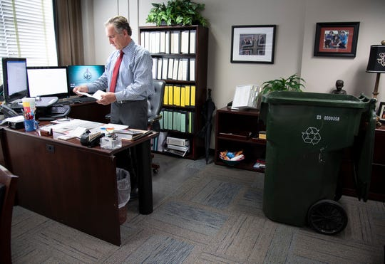 Williamson County Schools Superintendent Mike Looney packs his office on May 13 as he prepares to leave the district for a new position in Fulton County, Georgia.