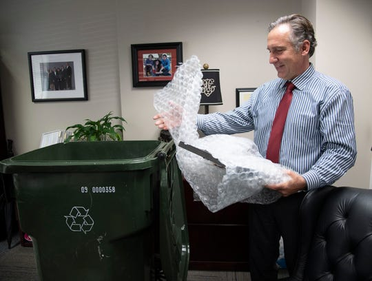 Williamson County Schools Superintendent Mike Looney packs his office as he prepares to leave the district for a new position in Fulton County, Ga., on Monday, May 13, 2019.