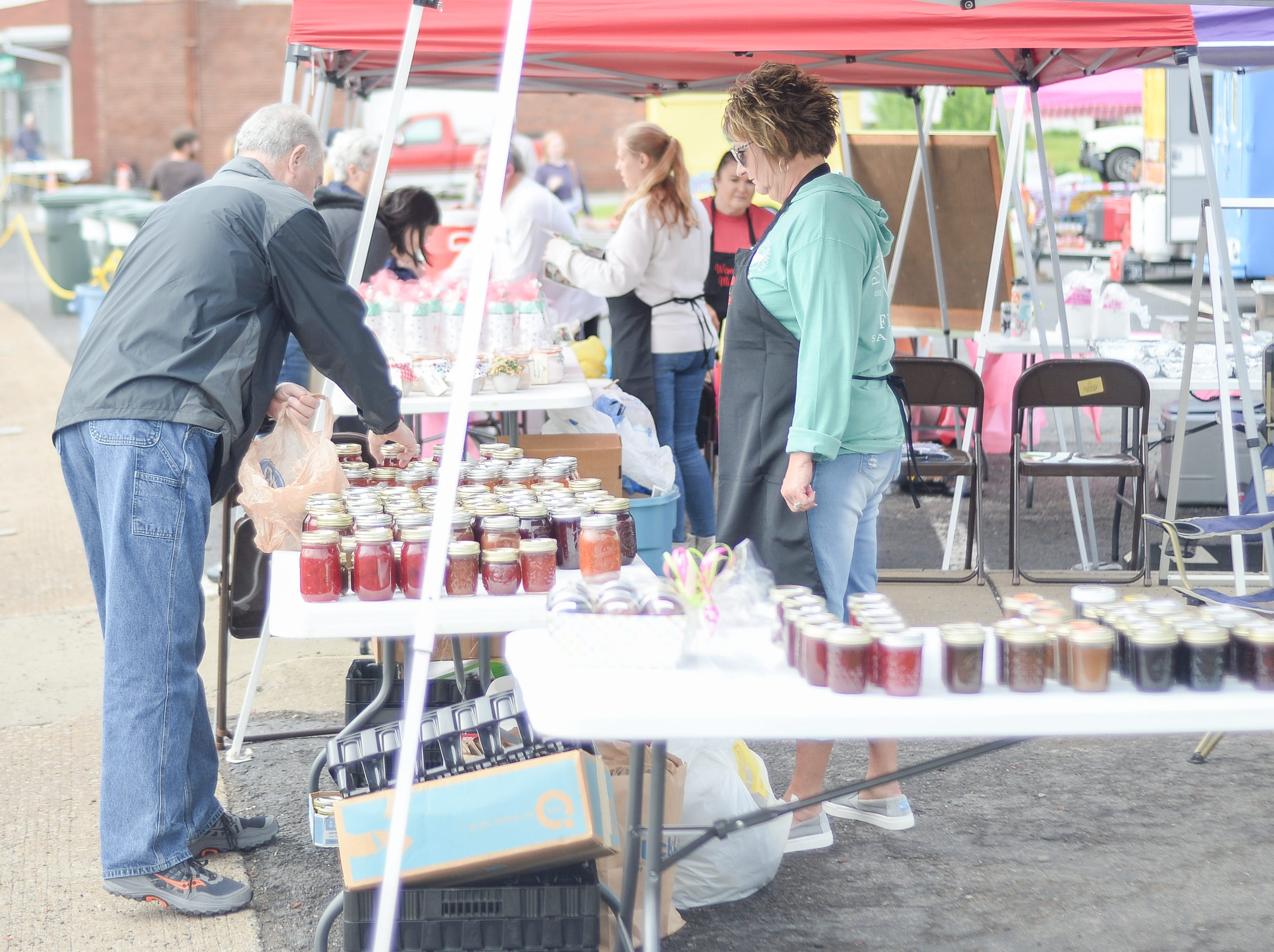 Attendees check out vendors during the 78th Annual Middle Tennessee Strawberry Festival presented by the Portland Chamber of Commerce in Portland on Saturday, May 11.