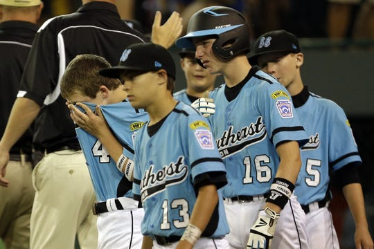 South Nashville's Austin Kasick, left, Conner Smith (13), Christopher McElvain (16) and Robert Hassell (5) leave the field  after a 6-5 loss in the Little League World Series on Aug. 20, 2013.
