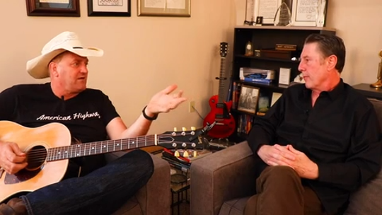 "Marty Brown, left, and Bart Herbison discuss the song ""I'm From the Country."""