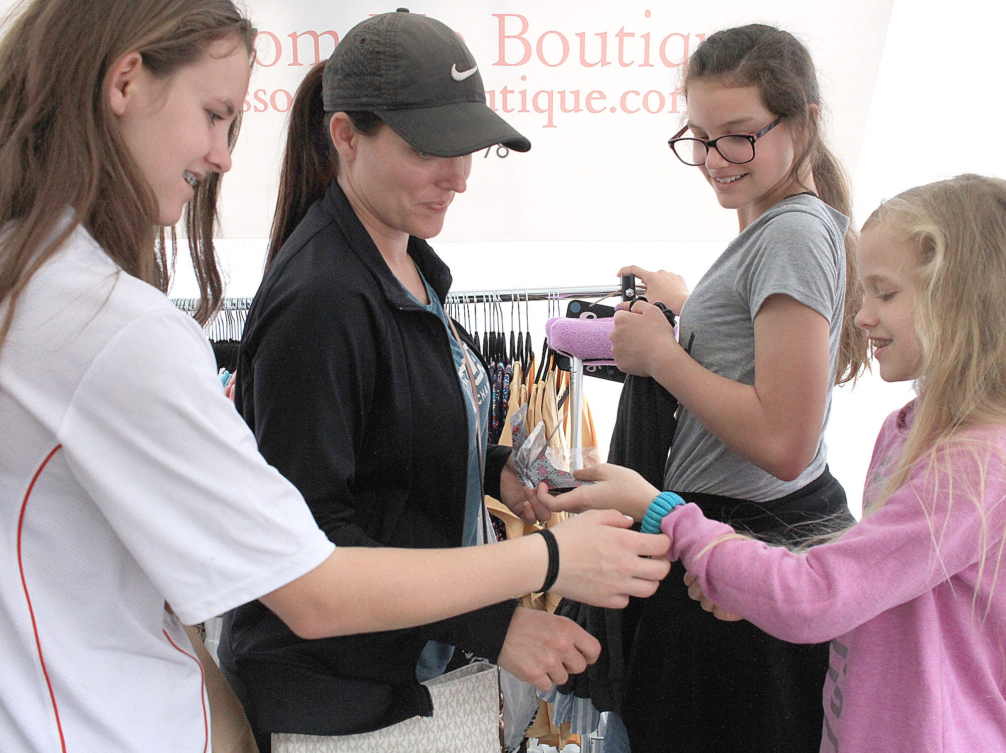l-R Mackenzie, Tiffany and Maddi Likness check out the bracelet Malorie picks out at the Fashion Crawl in Gallatin, TN on Saturday, May 11, 2019.