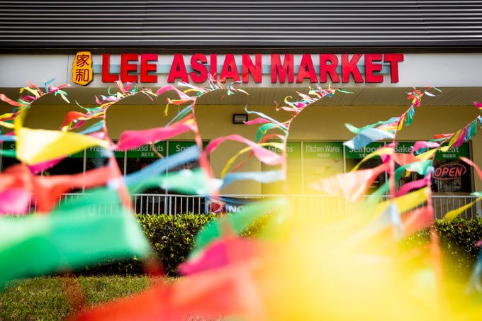 Flags from the grand opening of Lee Asian Market still decorate the storefront in Naples on Monday, May 13, 2019. The international grocery store carries items from a variety of countries, including China, Japan, Thailand, Vietnam, and the Philippines.