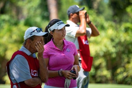 Alexa Pano, a 14-year-old golf phenom, center, talks to her father, Rick, who is caddying for her before teeing off from 8th hole during the first day of 5th U.S. Women's Amateur Four-Ball Championship at Timuquana Country Clug in Jacksonville on April 27. The 2020 event will be at Quail Creek Country Club in Naples.