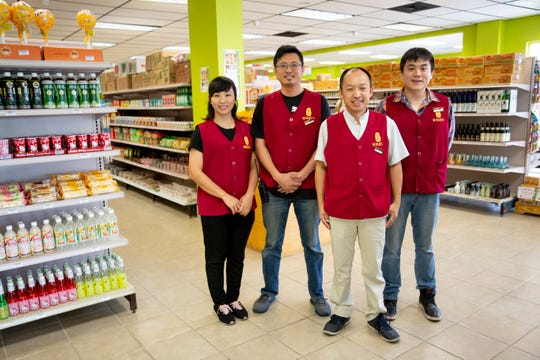 From left to right, Xiaoxia Xu, Manager Eric Lin, Owner Du Hao Guo, and Manager Dean Liu, pose for a portrait at Lee Asian Market in Naples on Monday, May 13, 2019.