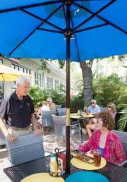 Owner Dick Jordan, left, chats with diner Sharon Carr of Bonita Springs atThe Garden Cafe in Bonita on April 2, 2016. The restaurant closed Saturday after operating more than three years.