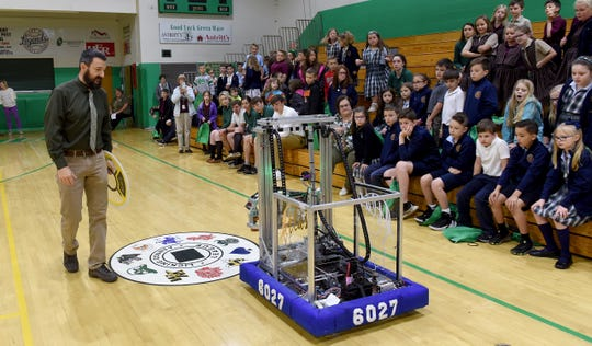 Newark Catholic teacher Russ Nelson talks about the Green Waves' robotics team's robot, Atlas, during a presentation for elementary students from Blessed Sacrament and St. Francis. Nelson is Robotics Instructor, STEM point person and Tech Coordinator at Newark Catholic.