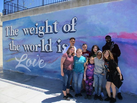 Volunteers and members of Halls That Inspire at the new mural.