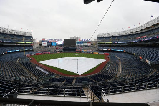 May 13, 2019; Bronx, NY, USA; A tarp covers the infield at Yankee Stadium before a scheduled game between the New York Yankees and the Baltimore Orioles.