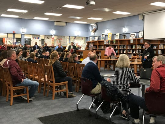 Waldwick Board of Education President Daniel Marro (right) takes questions from the audience after the board adjourned for the evening.