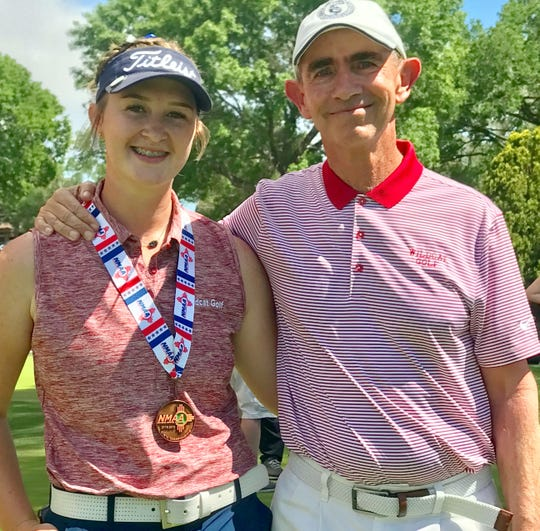 Junior Lady 'Cat Presley Jackson earned Class 5A All-State honors with her third place individual finish at the state tournament. She is with Coach James Williams.