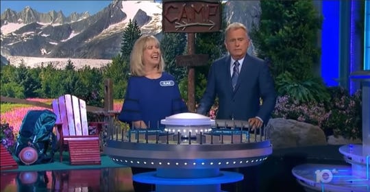 "Las Cruces resident Rae Wilson enjoys a banter with ""Wheel of Fortune"" host Pat Sajak during the bonus round of the show, May 13, 2019."