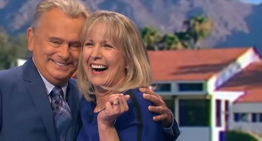 """Wheel of Fortune"" game show host Pat Sajak gives Rae Wilson of Las Cruces a hug after she won a trip to Maui, Hawaii, on Monday night's episode."