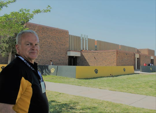 Alamogordo High School Principal Dr. Ken Moore stands in front of AHS.