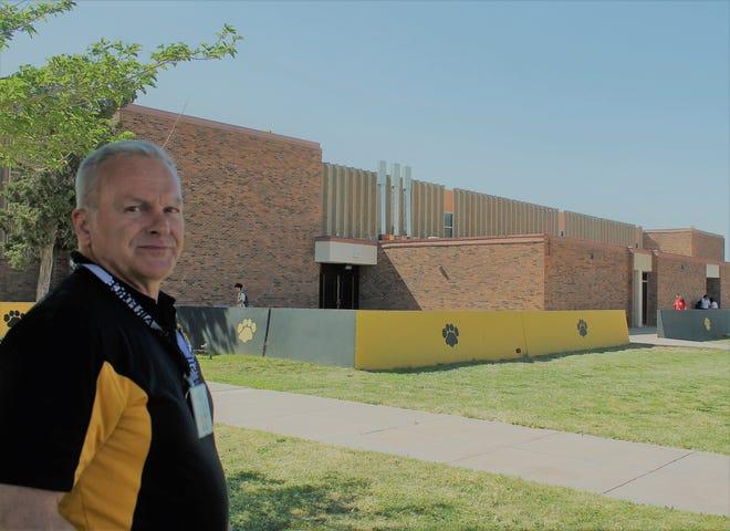 File photo of Alamogordo High School Principal Dr. Ken Moore standing in front of AHS.