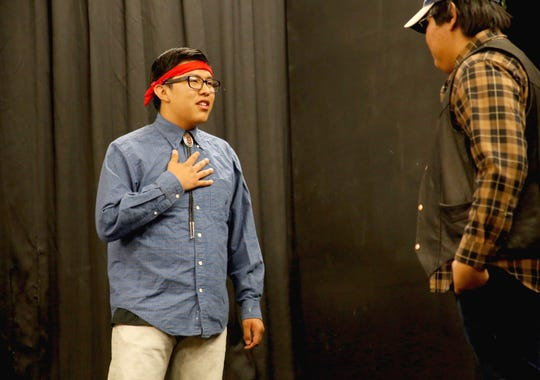Thomas Hosteen, left, and Dion Lorenzo act a scene in the play by Newcomb High School's first theater class on May 13 in Newcomb.
