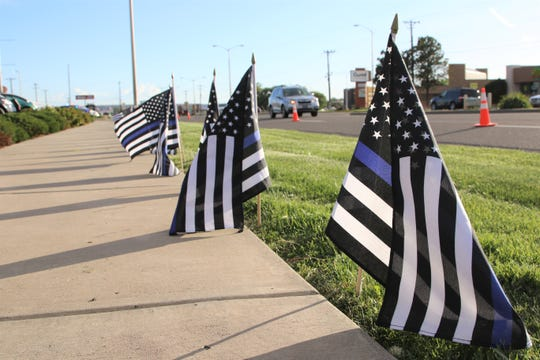 There were 163 flags set up along East Main Street during the Annual San Juan County Law Enforcement Memorial and Candlelight Vigil on May 13 at the Farmington Museum at Gateway Park. Each flag represented an officer who died in the line of duty in 2018.
