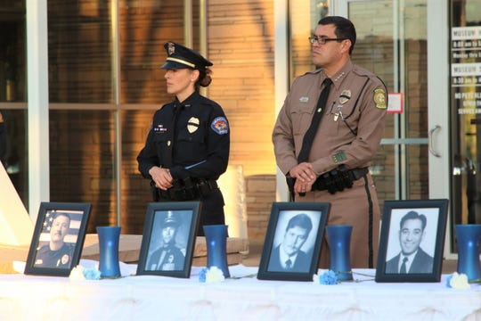 Farmington Police Deputy Chief Jessica Tyler, left, stands next to Navajo Police Department Chief Phillip Francisco, right, during the Annual San Juan County Law Enforcement Memorial and Candlelight Vigil on May 13 at the Farmington Museum at Gateway Park. Francisco was the keynote speaker.