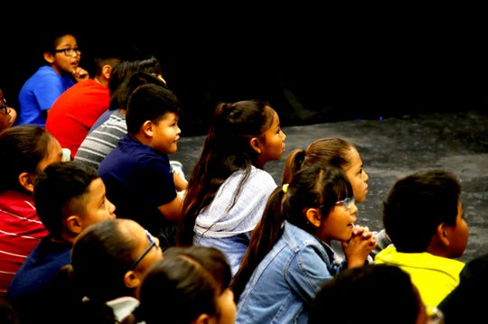 Newcomb Elementary School students watch the performance by the first theater class at Newcomb High School on May 13.