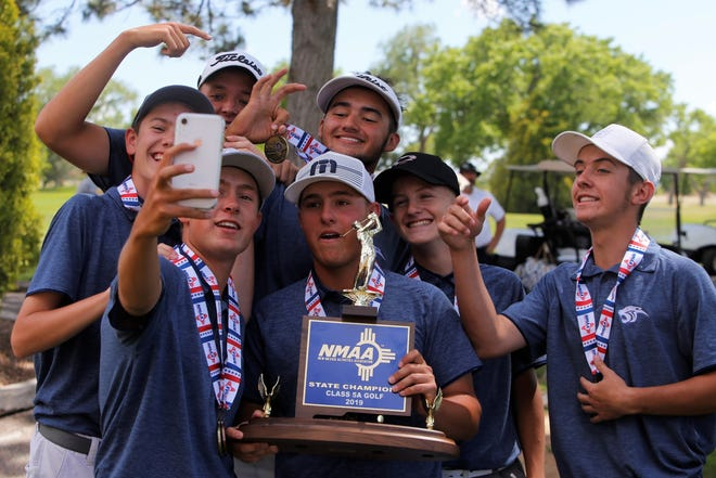 The Piedra Vista boys golf team takes a selfie of its second-straight blue trophy after winning the 5A boys golf state championship on Tuesday, May 14, 2019 at the Canyon Club in Albuquerque.