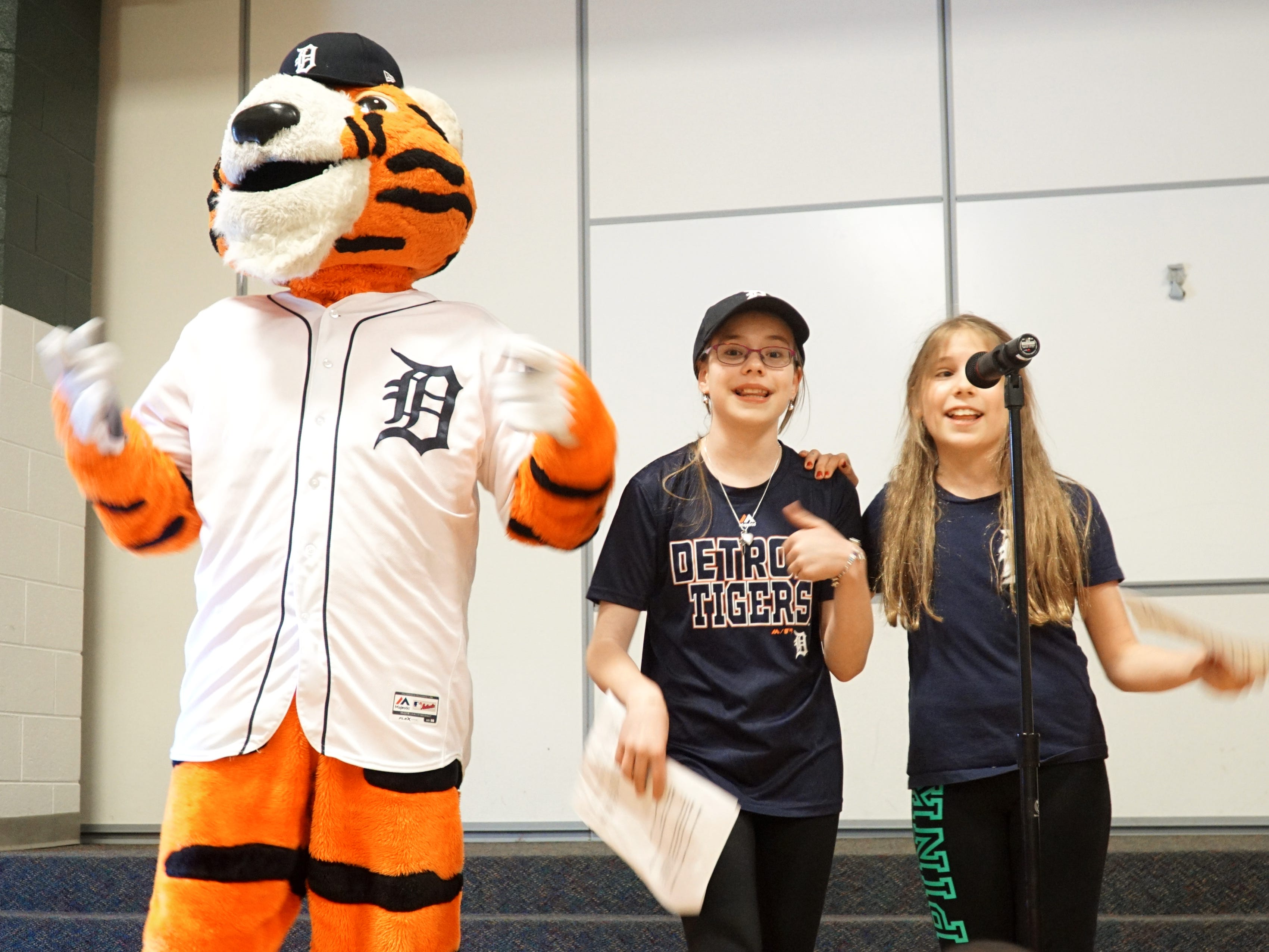 When Tigers' mascot Paws joined MCs Tricia Beattie and Margo Kaledas, right, Principal Learned knew something was up.
