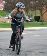 Amelia Nordhaus, 7, is planning a bike-a-thon at an elementary school near her house to benefit multiple sclerosis.