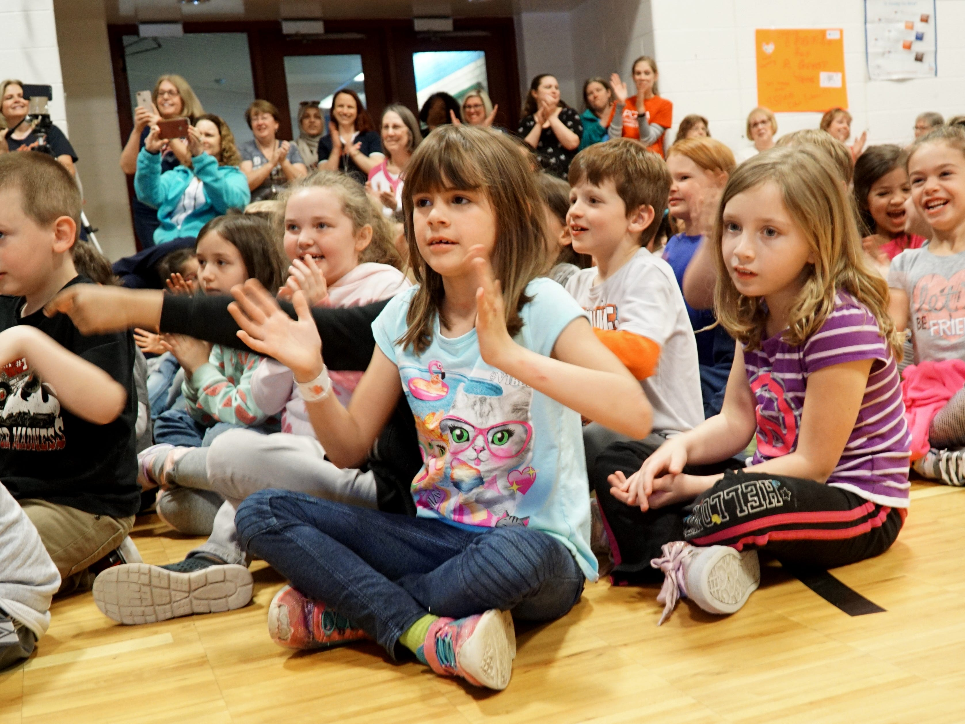 Eriksson students applaud their and their principal's efforts during a May 14 assembly.