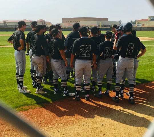 Members of the Xavier Prep baseball team gather on the field before Tuesday's CIF Division 5 semifinal playoff game against Orange Vista.