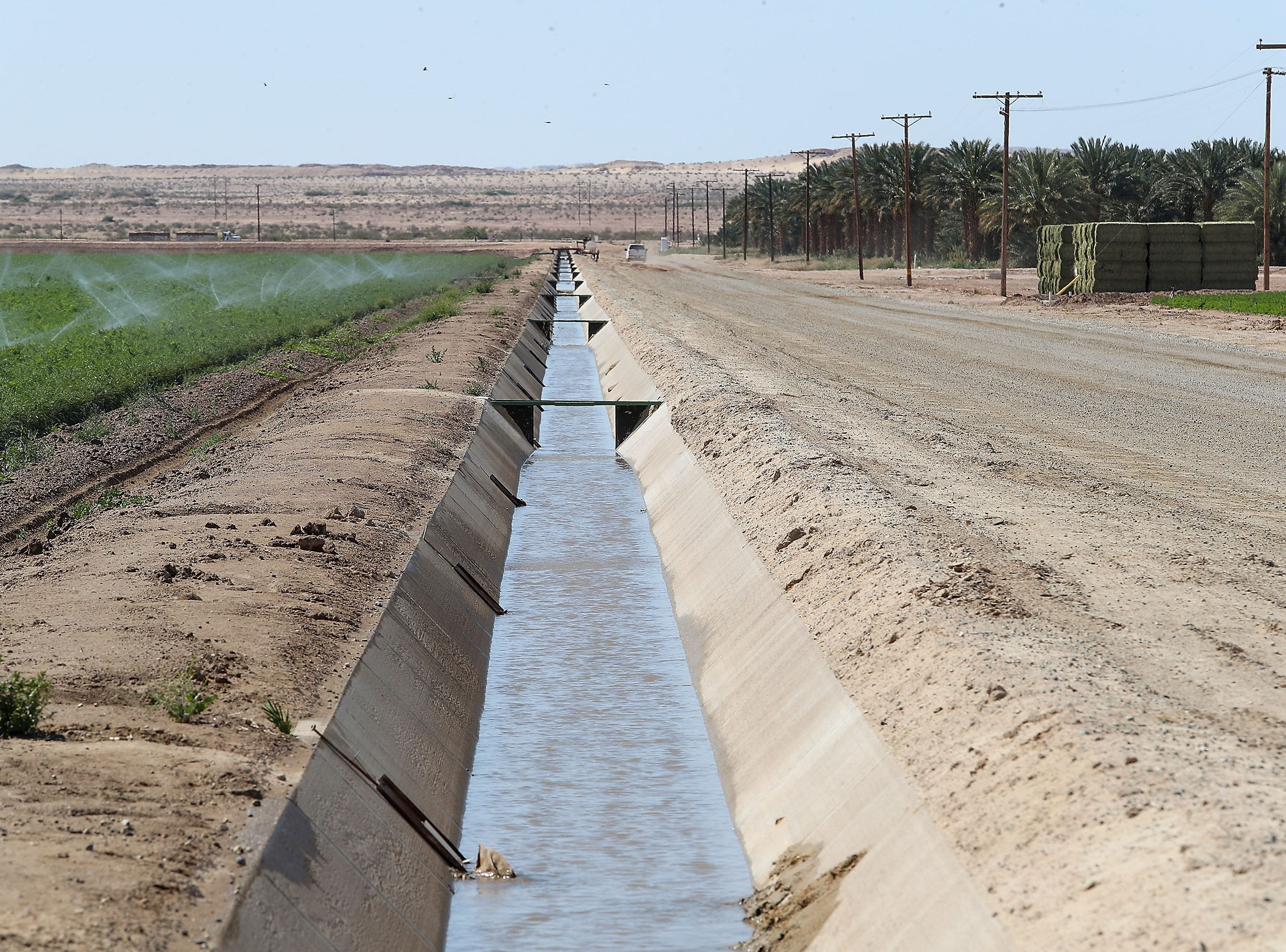 Water flows through a irrigation canal on the Elmore Desert Ranch which sits on the edge of the Salton Sea near Brawley, April 11, 2019.
