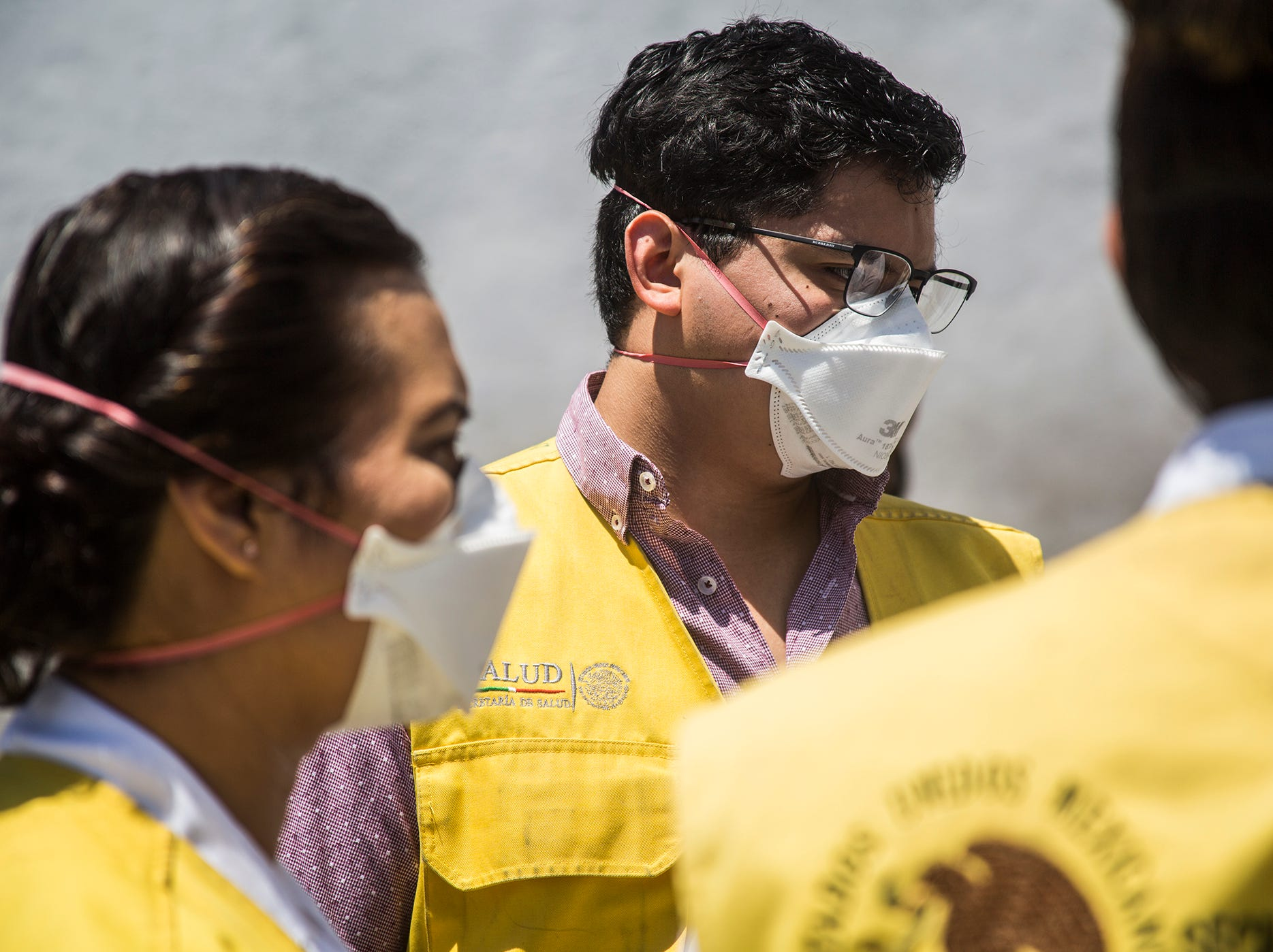 Health workers from the state government of Baja California visit the Casa de Ayuda Alfa y Omega surveying infected migrants on May 14, 2019.