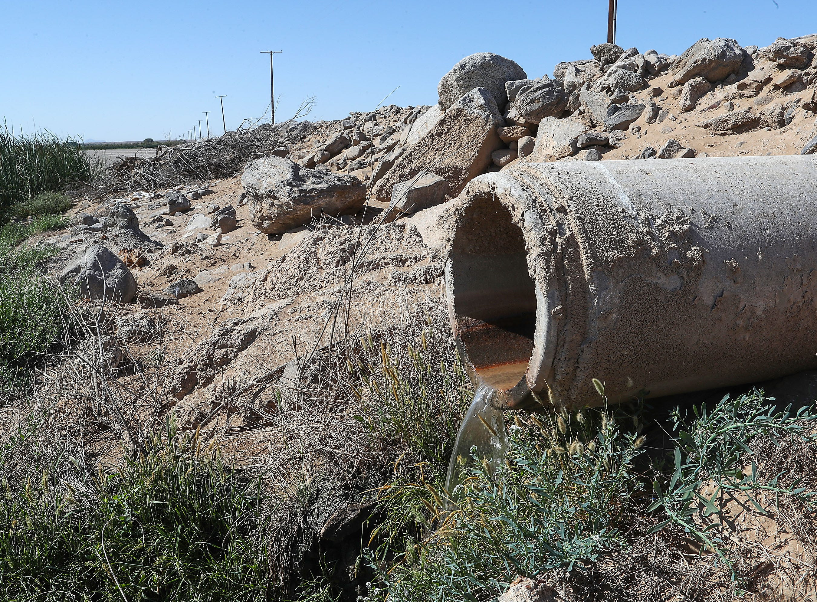 A drainage pipe carries farm runoff water to the Salton Sea from the Elmore Desert Ranch near Brawley, April 11, 2019.