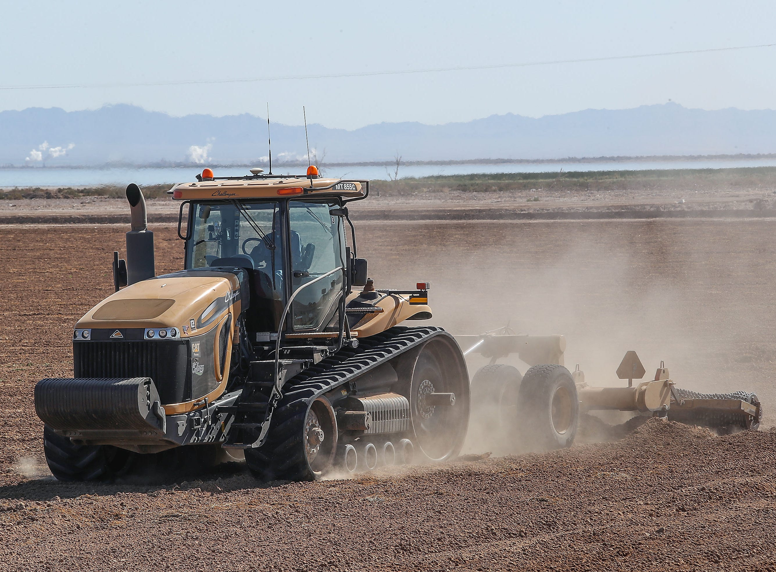 A tractor is used to farm land on the Elmore Desert Ranch which sits on the edge of the Salton Sea near Brawley, April 11, 2019.