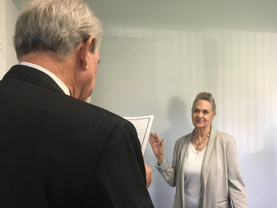 A judge swears in Judy Vossler Tuesday during a Coachella Valley Cemetery District board meeting. Vossler was appointed to the board and attended her first meeting.