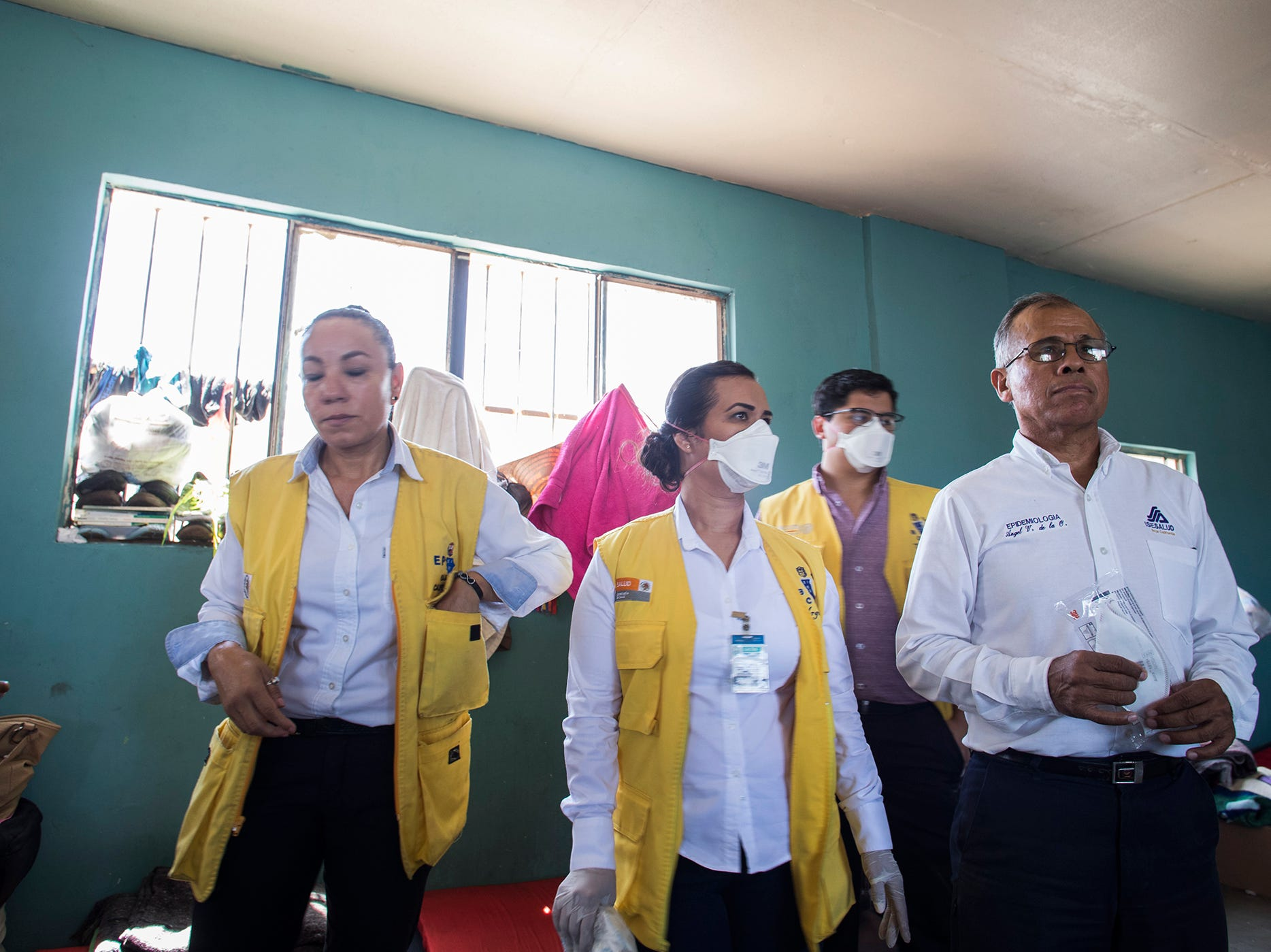 Health workers from the state government of Baja California visit the Casa de Ayuda Alfa y Omega surveying infected chickenpox migrants on May 14, 2019.