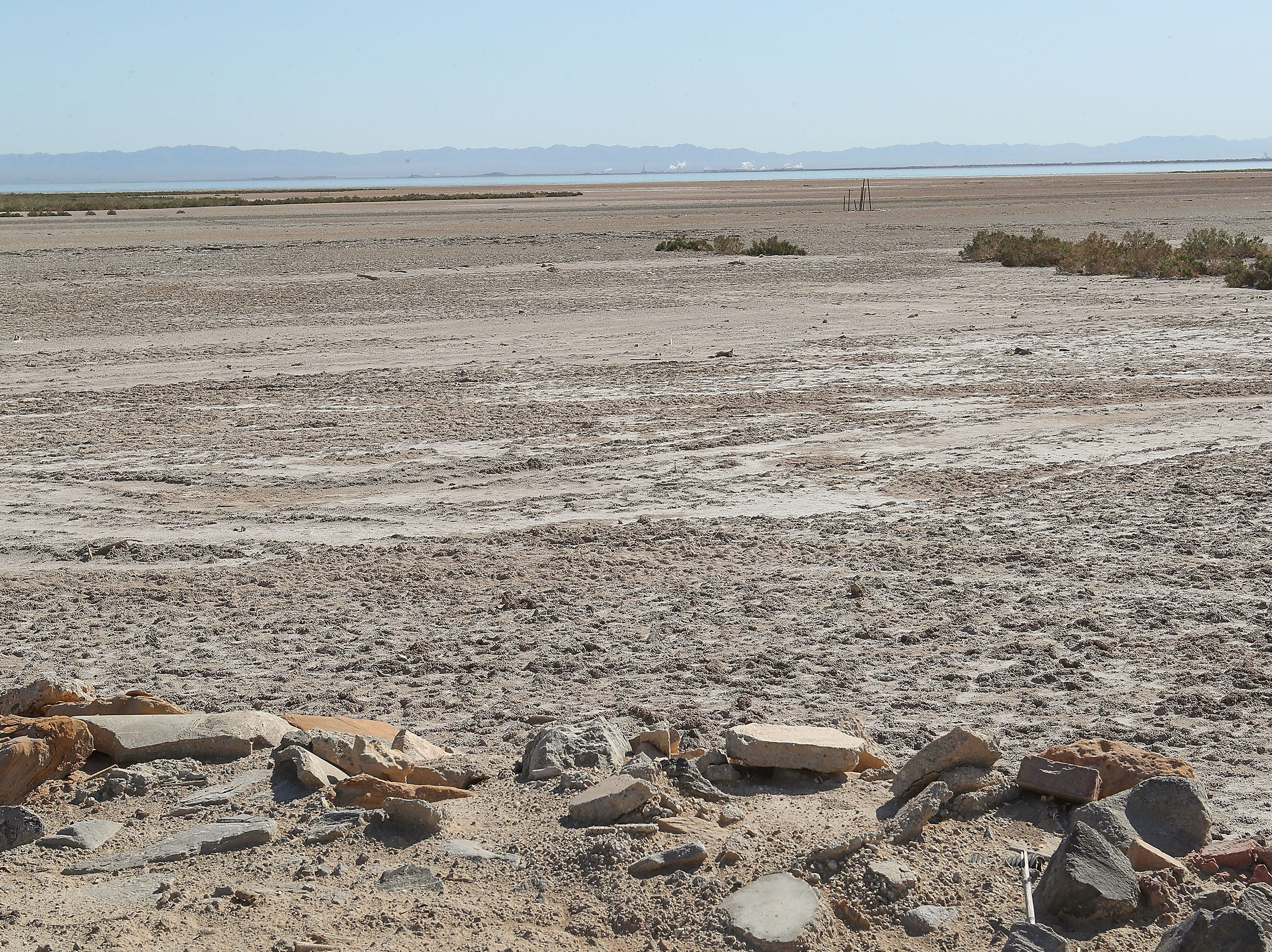 The shrinking Salton Sea can be seen in the distance beyond an area of exposed playa where the shoreline used to abut the Elmore Desert Ranch near Brawley, April 11, 2019.