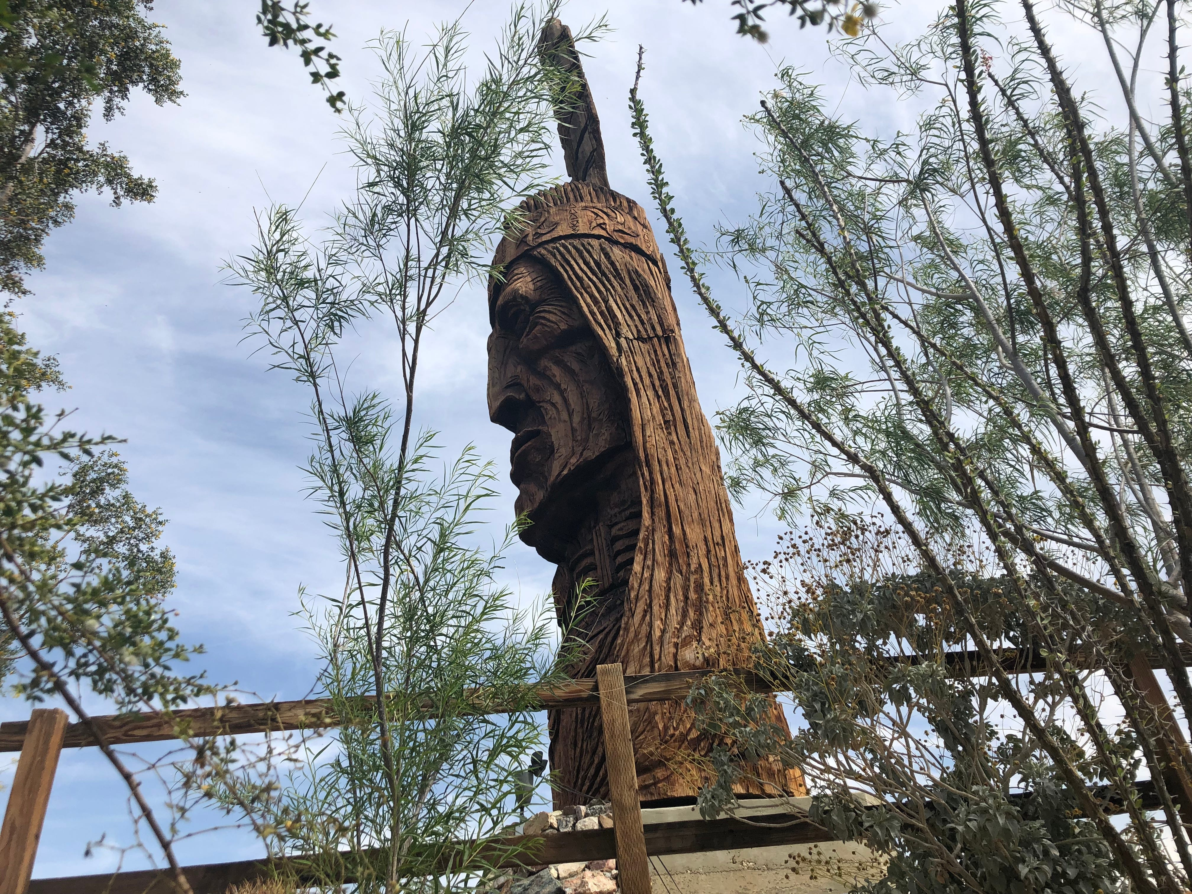 "Waokiye at Cabot's Pueblo Museum in Desert Hot Springs. Carved by artist Peter ""Wolf"" Toth, Waokiye was completed in May 1978. Waokiye's face is 22 feet tall and was carved from a single 45-ton Sequoia redwood log that was donated to the museum. The feather is 15 feet tall and was created from an Incense Cedar from Idyllwild. Waokiye means ""traditional helper"" in the Lakota language."