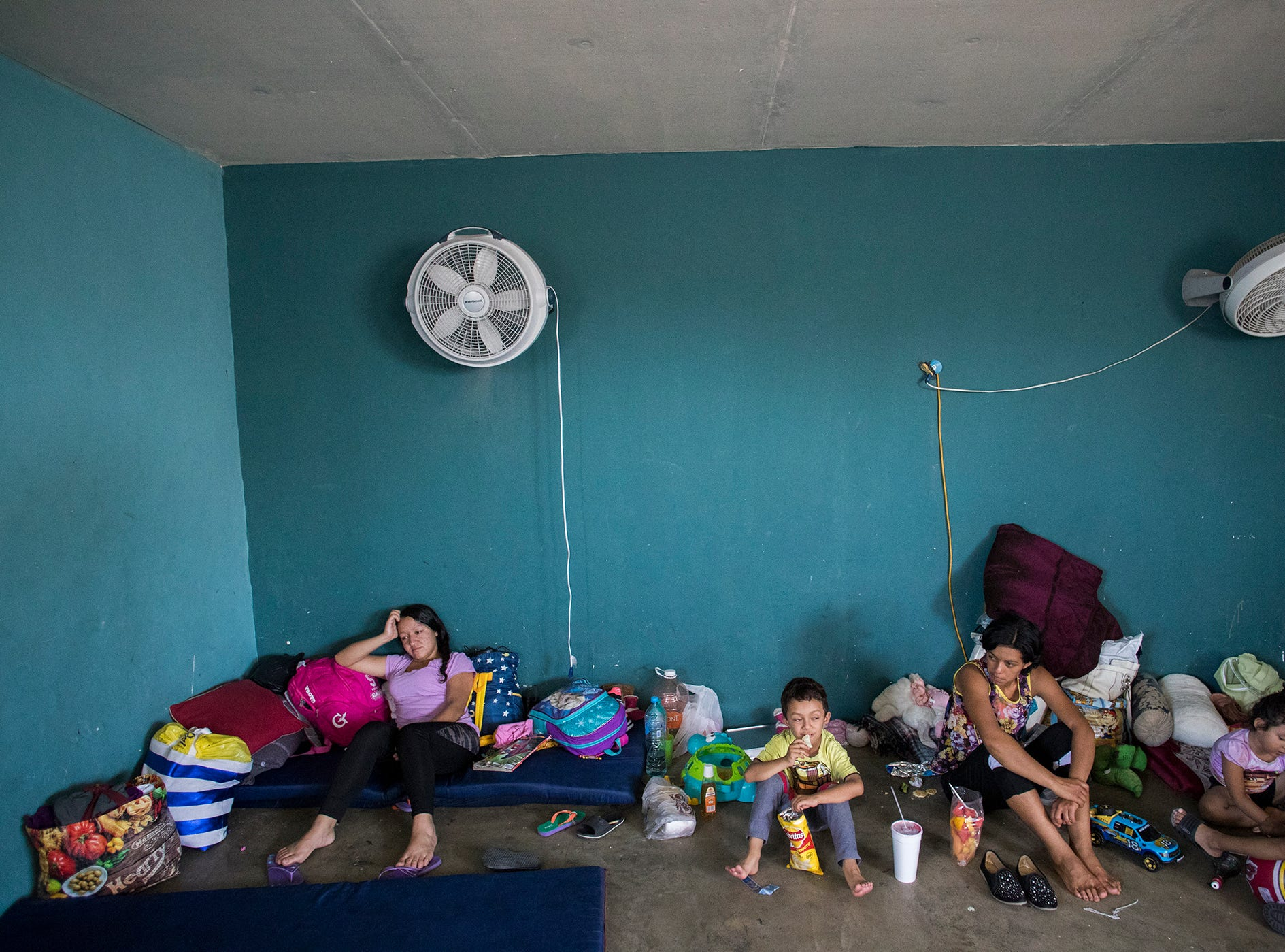 At far left, Maricela Lopez, a migrant who was returned to Mexico under the Migrant Protection Protocol asylum policy rests at the Casa de Ayuda Alfa y Omega migrant shelter. Lopez was not allowed into the U.S. for her court hearing after U.S. agents noticed she had symptoms of chickenpox.