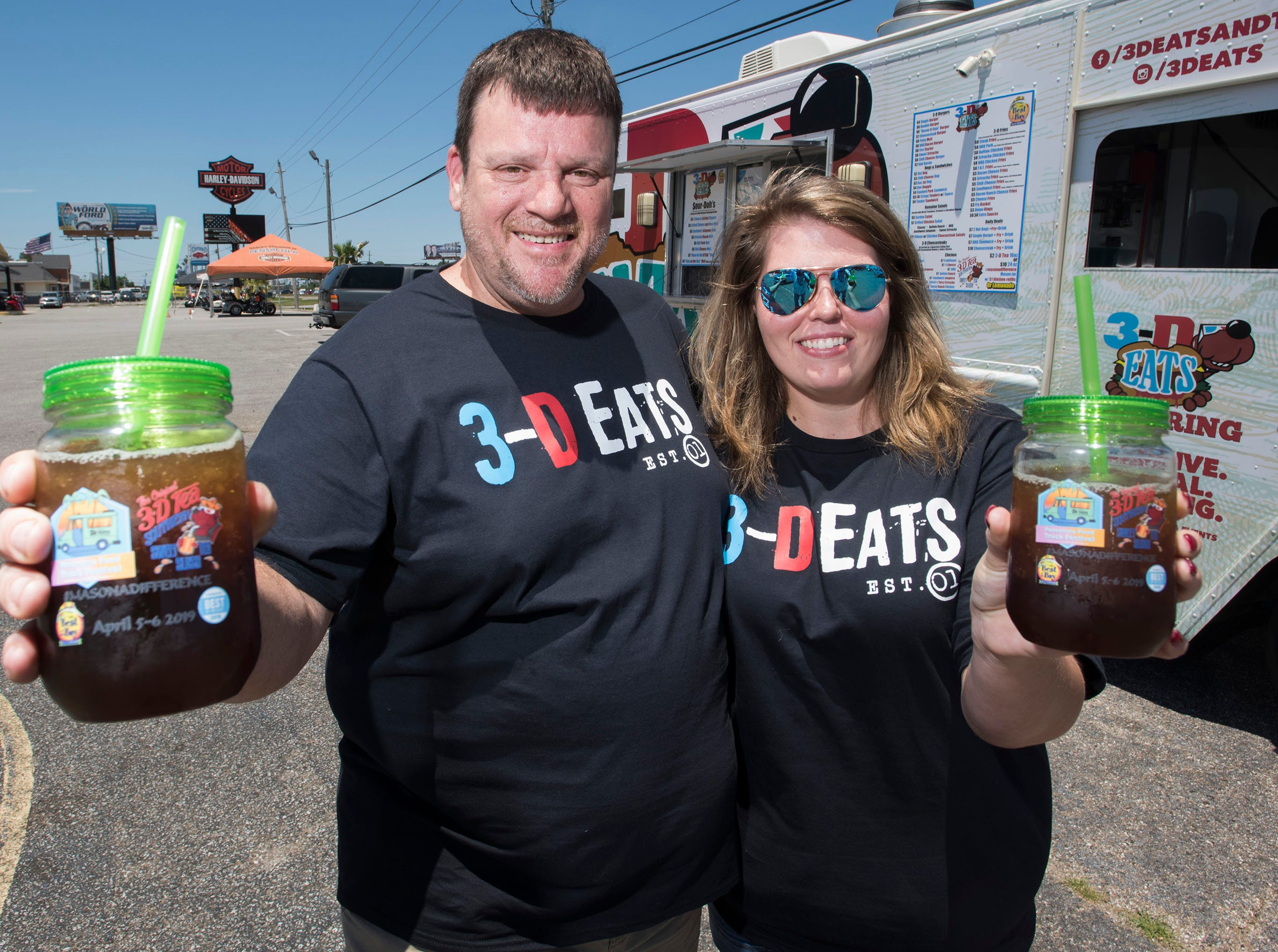 3D Eats food truck owners, Sean DeSmet and his wife, Brooke, show off the Mason a Difference drink jars available at their food truck on Tuesday, May 14, 2019. The couple sells the Mason jars to raise money for local charities.