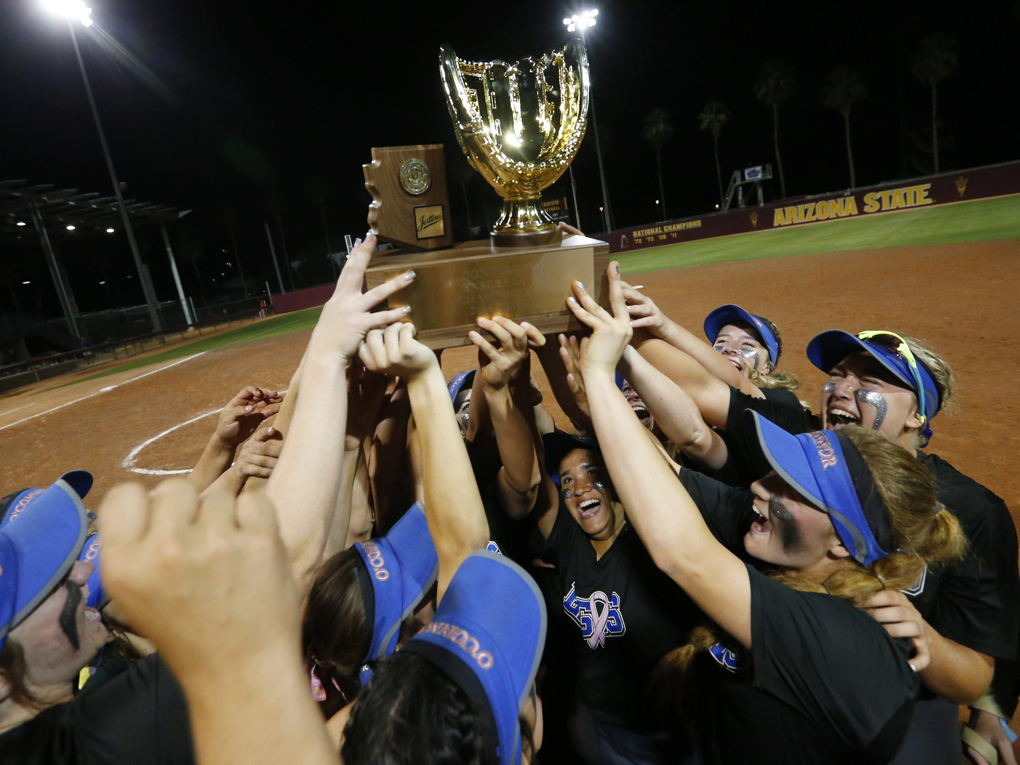 Sandra Day O'Connor players celebrate after beating Pinnacle 6-4, winning the 6A State Softball Championship in Tempe, Ariz. May 13, 2019.